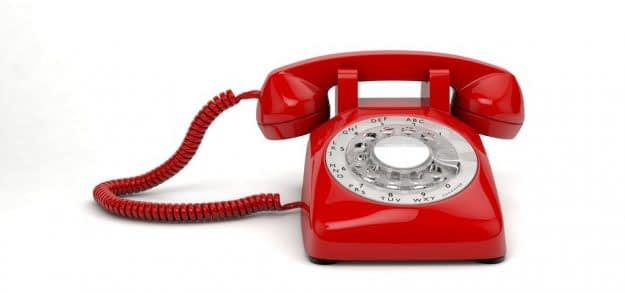 Plastic Red Emergency Phone on White Background